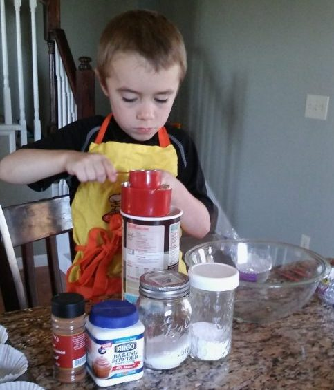 child helping to cook